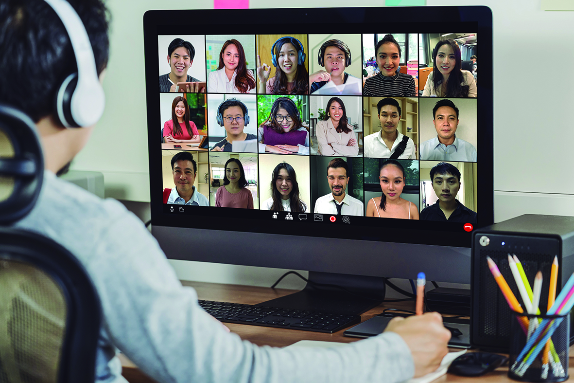 Rear view of Asian businessman working and online meeting via video conference with colleague and team building when Covid-19 pandemic,Coronavirus outbreak,Social distancing and new normal concept